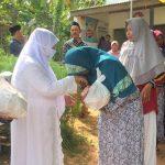 Blusukan di Dua Desa, Pasangan Fauzi-Eva Bagikan Paket Sembako di Akhir Pekan