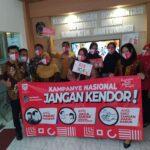 Peringati HKN Ke-56 Dinkes Banyuwangi Bagi-bagi Masker dan Kampanye 3M