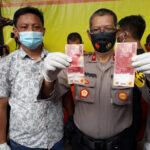 Polisi di Surabaya Tangkap Pengedar Uang Palsu
